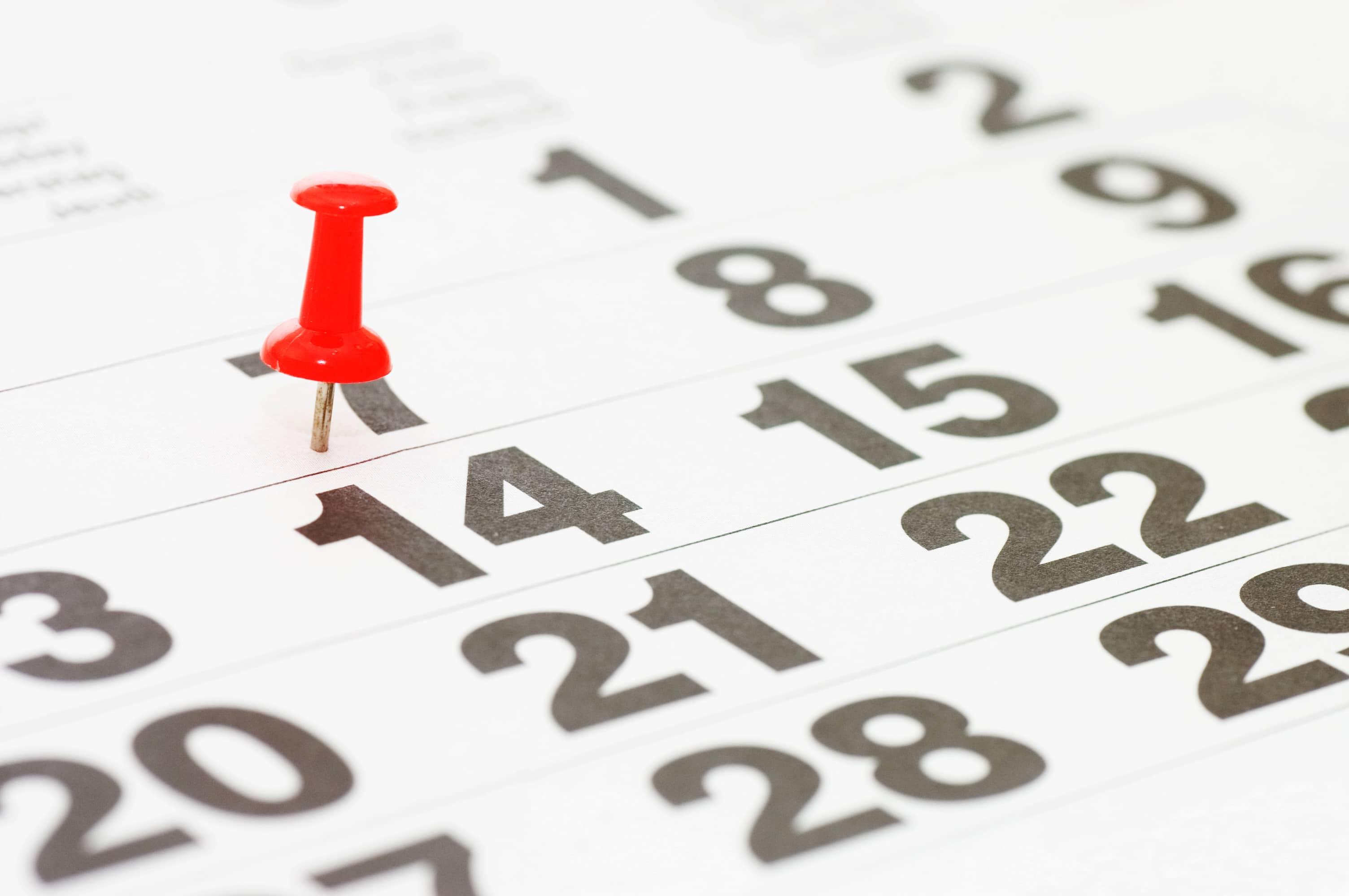 Kalenderblad med markering för den 14:e i månaden